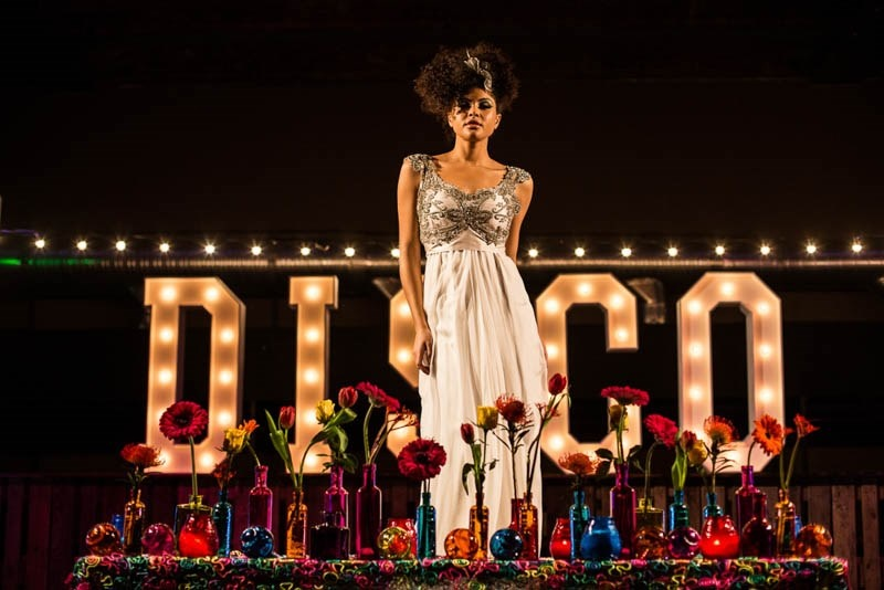Picture Of bright and fun 70s disco inspired wedding with an industrial feel  8