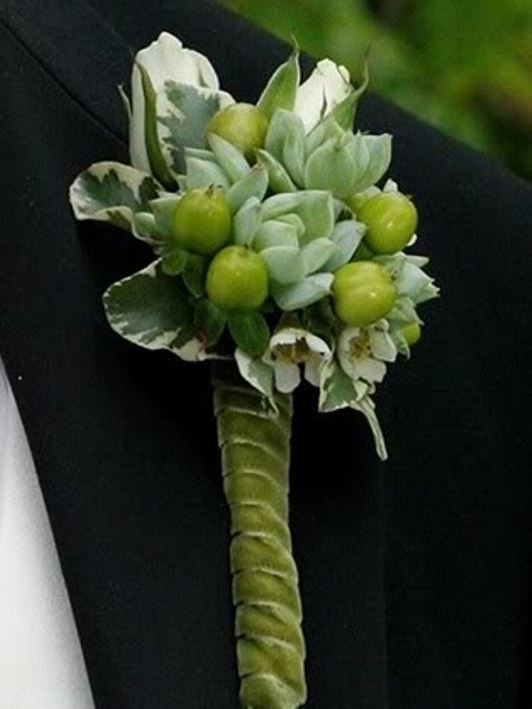 a creative succulent, berry and greenery wedding boutonniere is a cute and stylish accessory