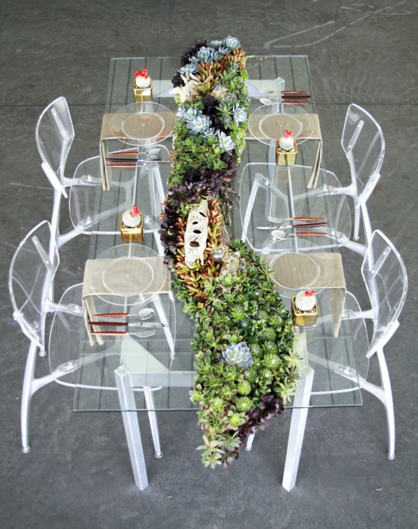 a sheer wedding table with a lush and long succulent wedding table runner of succulents of various shades