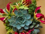a bright wedding bouquet of bold blooms and succulents is a creative and chic idea to go for