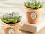 pots with succulent candles are creative and a bit unexpected wedding favors