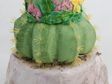 a fun colorful cactus wedding cake with a colorful tier with floral appliques is a gorgeous wedding dessert idea