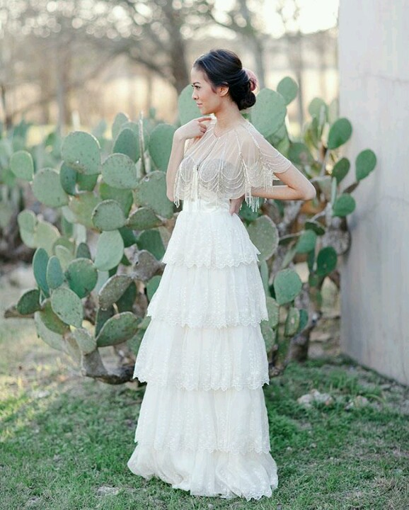a bridal portrait and lots of cacti as a backdrop for a cool desert wedding or to show off that it's summer