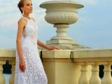 a crochet A-line halter neckline wedding dress plus statement earrings for a boho Greek wedding