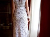 a crochet maxi wedding dress with a fitting silhouette, with cap sleeves and various patterns for a beach or boho bride