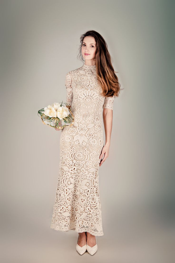a grey crochet lace fitting maxi wedding dress with short sleeves and a high neckline, white shoes for a modest wedding look