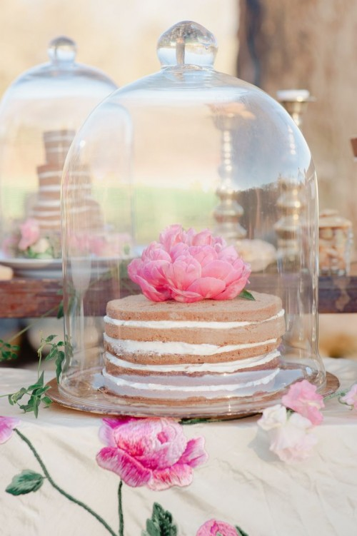 naked cakes topped with fresh blooms can be saved from bugs in cloches that will match a garden bridal shower
