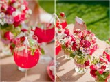 bright florals in jars and pink punch for a colorful garden bridal shower are amazing