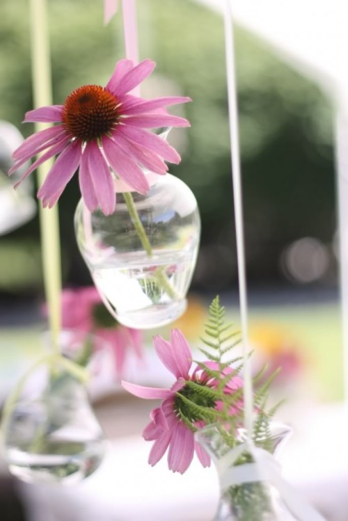 fresh blooms and greenery in hanging vases and bottles will make your space feel very romantic and garden-inspired
