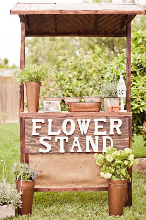 a flower stand with blooms and greenery can be used for a garde bridal shower activity - making floral arrangements or bouquets