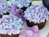 chocolate cupcakes with purple and blue sugar blooms are adorable and delicious for a garden bridal shower