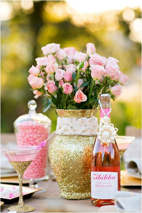 a glam garden bridal shower centerpiece of a gold glitter vase with pink roses