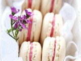 a box with macarons and blooms is a delicious and cool bridal shower favor for each gal