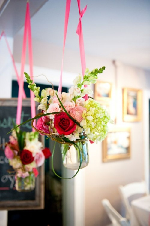 bright blooms in jars hanging on bright ribbon will be a lovely idea for having a garden bridal shower