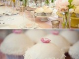 a beautiful pastel wedding tablescape with blush peonies and greenery, with a blush table runner and lots of sweets around