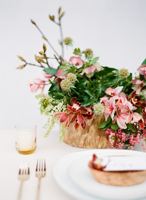 Charming pink and burgundy wedding centerpiece with