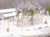 lavender in jars and bottles are right what you need for spring bridal shower centerpieces