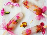 floral popsicles with bows are a nice and refreshing sweet idea for a spring bridal shower