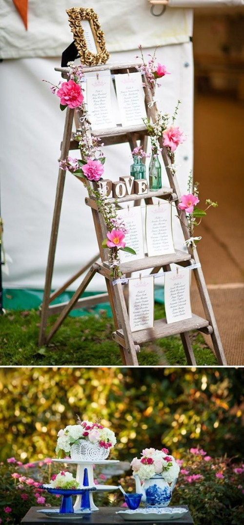 a spring bridal shower seating chart with tables, pink blooms and blooming branches
