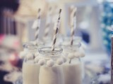 dress up jars or mugs with drinks with white pompoms to make them look wintry-like and cozy