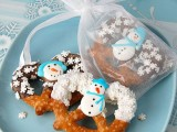 pretzels with snowflakes and snowmen are delicious and fun desserts and favors at the same time