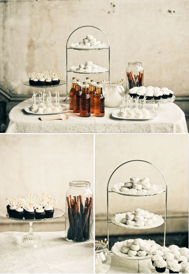 a stylish and simple dessert table with ltos of white desserts like cookies, macarons, cupcakes and some drinks in bottles