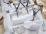 make skewers of marshmallows with large diamonds on top to create a chic and bold look