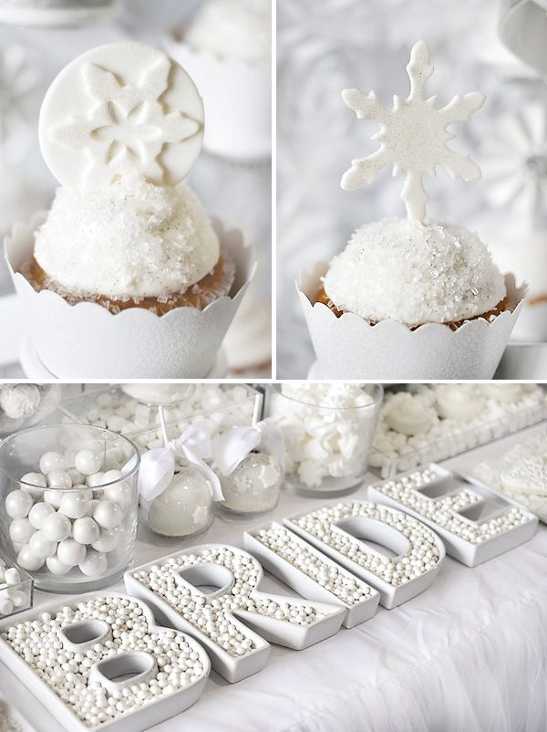 cupcakes with icing and small snowflakes on them will scream winter and an all white candy table is also great for a winter bridal shower