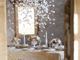 hang some marshmallows over the tables to imitate snow, it's a pretty and veyr whimsy idea for decorating
