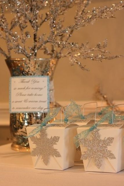 pack your bridal shower gifts into chic white boxes with blue ribbons and snowflakes to embrace the season