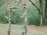 a woodland wedding arch of branches and twigs, with some leaves is a simple idea to realize yourself