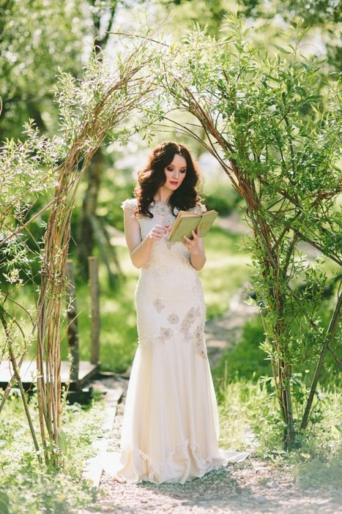 a simple wedding arch of branches and greenery is a fresh and cool idea for a spring or summer wedding