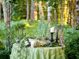 a simple and fresh branch wedding arch with much foliage and greenery is a lovely idea for a spring or summer wedding