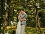 a woodland wedding arch of branches with greenery and neutral blooms is a romantic and simple idea for a spring or summer woodland wedding