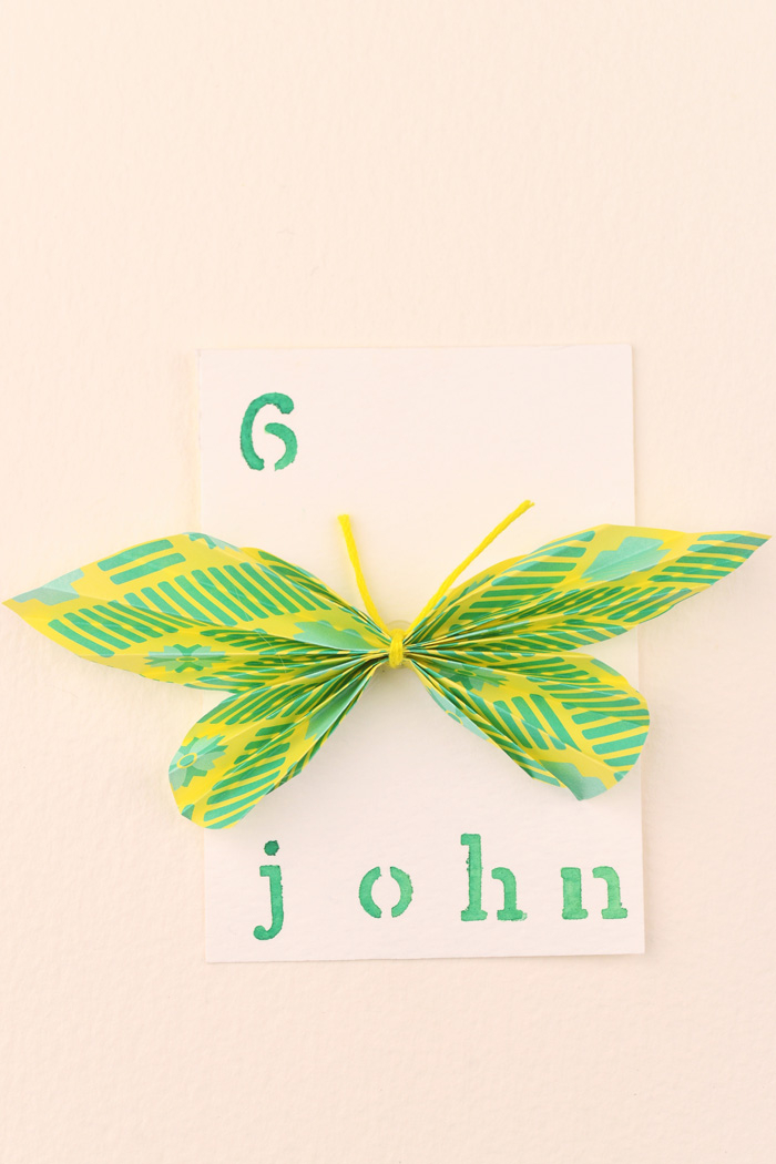 Picture Of cheerful and bright diy paper butterfly escort cards  10