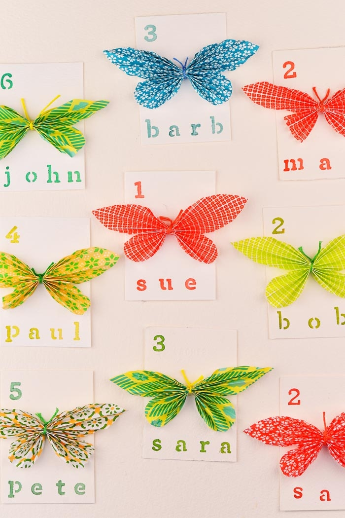 Picture Of cheerful and bright diy paper butterfly escort cards  2