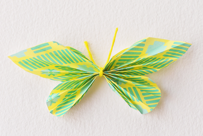 Picture Of cheerful and bright diy paper butterfly escort cards  8