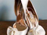 white peep toe shoes with large fabric blooms will add classic chic to your bridal style