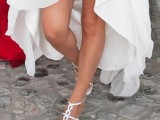 embellished white wedding shoes with a chain is a chic and bold pair of shoes with a sparkly touch