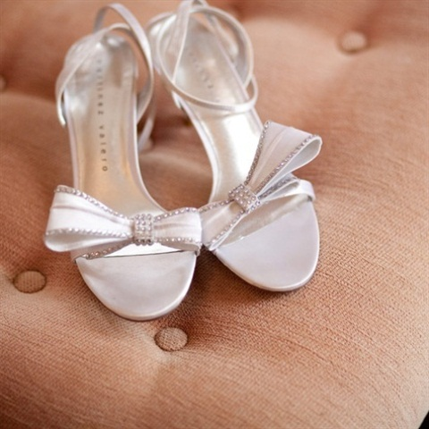 elegant white heeled sandals with embellished bows and ankle straps are a chic idea for a retro bridal look