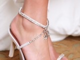 white strappy fully embellished wedding shoes with hanging crystals are glam, sparkly and shiny