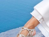 grey strappy laser cut fully embellished wedding shoes will make your bridal look super chic, glam and bold