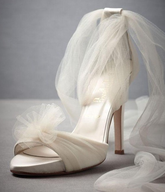 white fabric high heels with a tulle bloom and tulle straps will give an ethereal touch to your bridal look
