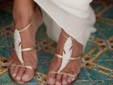 glam gold strappy shoes with embellished feathers will highlight your look and will be nice for a hot day