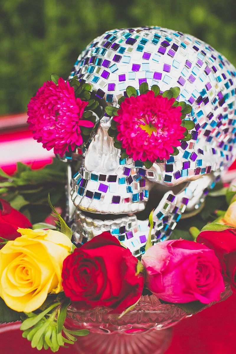 Picture Of colorful diy mosaic skull wedding centerpiece  1