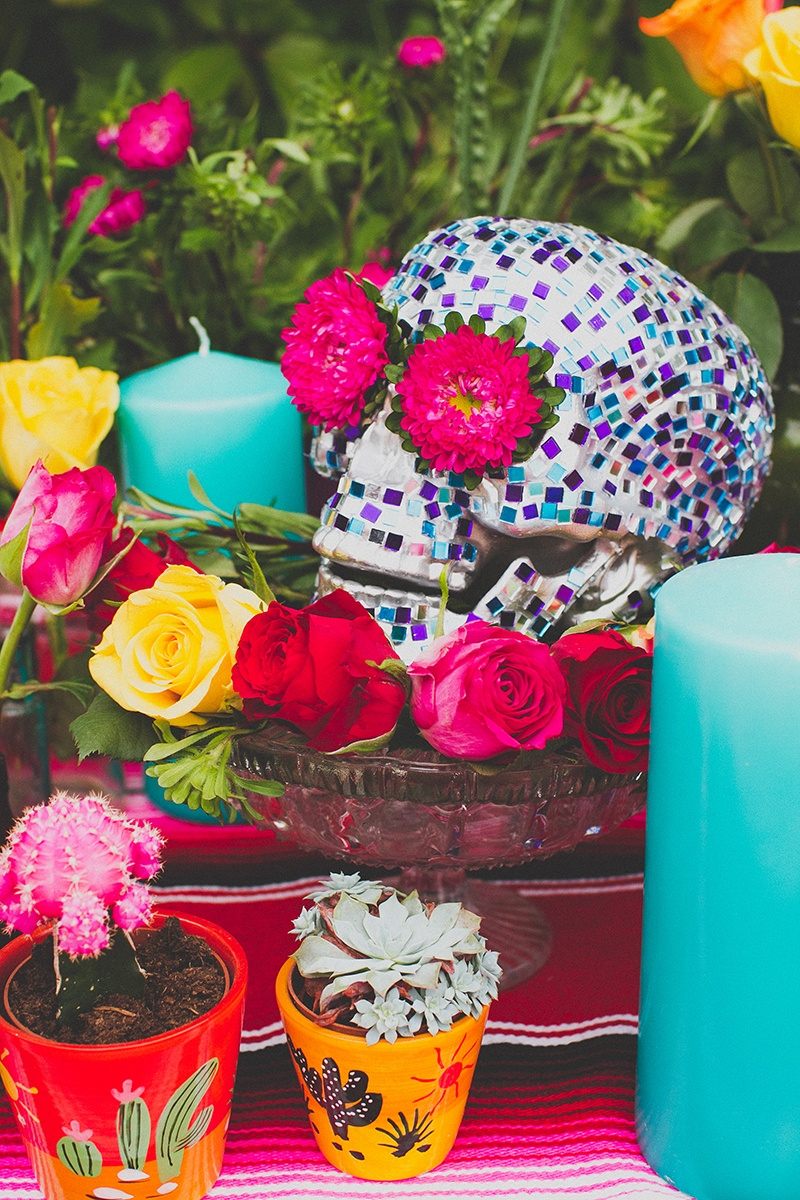 Picture Of colorful diy mosaic skull wedding centerpiece  11