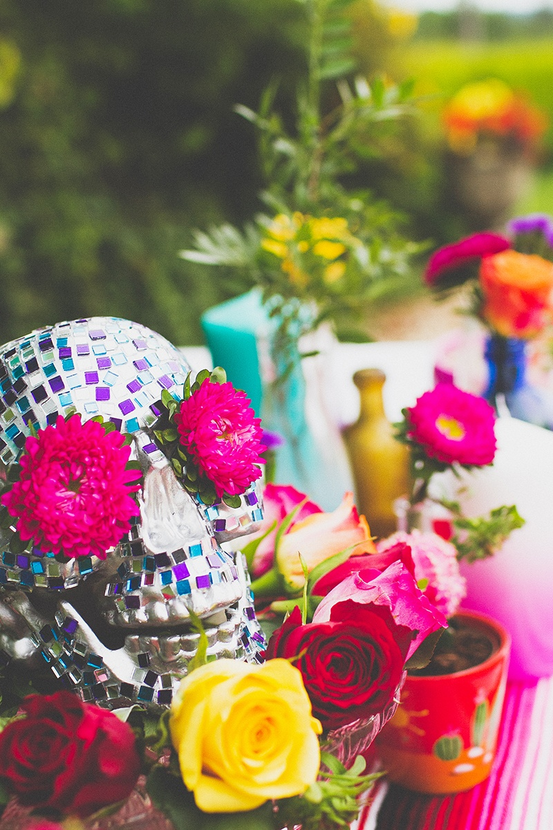 Picture Of colorful diy mosaic skull wedding centerpiece  2