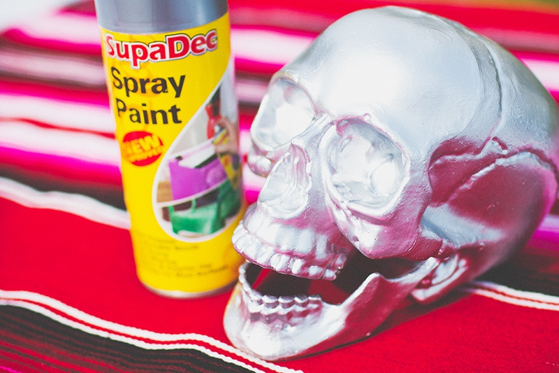 Picture Of colorful diy mosaic skull wedding centerpiece  3