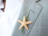accent your beach attire with a little themed boutonniere to give a nod to your location