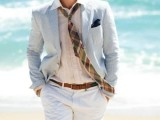 a blush shirt, a thin striped blue jacket, white shorts and a tie are a formal but comfy look for a wedding